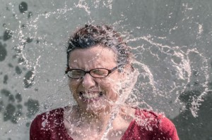 Girl getting splashed